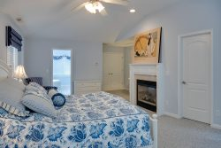blue master bedroom with fireplace