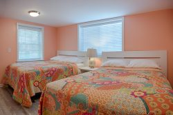 coral bedroom with whimsical bedding