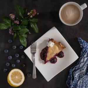 blueberry pie blueberries lemon and cup of cappaccino
