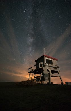 stars milkyway behind a lifeguard station in chincoteague virginia