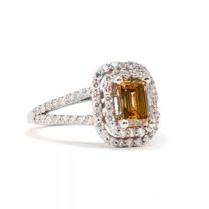 square cut citrine ring surrounded by diamonds