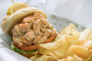 shrimp salad sandwich and golden chips