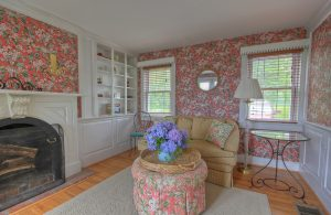 country cottage floral themed living room with fireplace