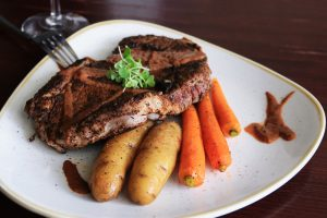 beef steak potatoes carrots plated