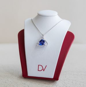 triangle sapphire necklace surrounded by diamonds