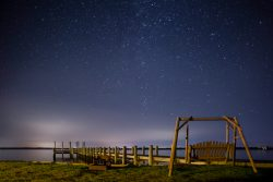gliding swing and dock overlooking stars